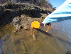 Pushing off a Rock with Kayak Paddle